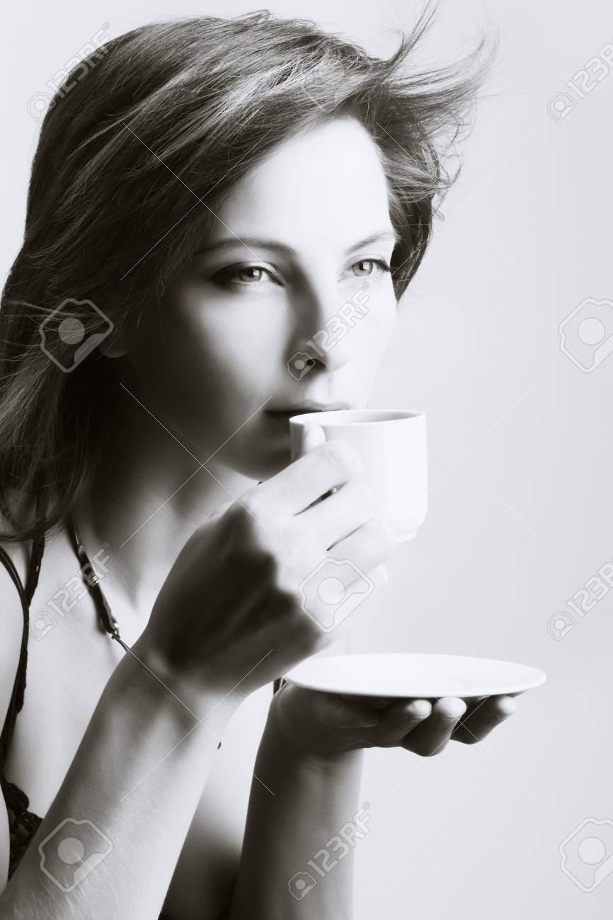 Portrait of beautiful woman drinking coffee Stock Photo - 3982144