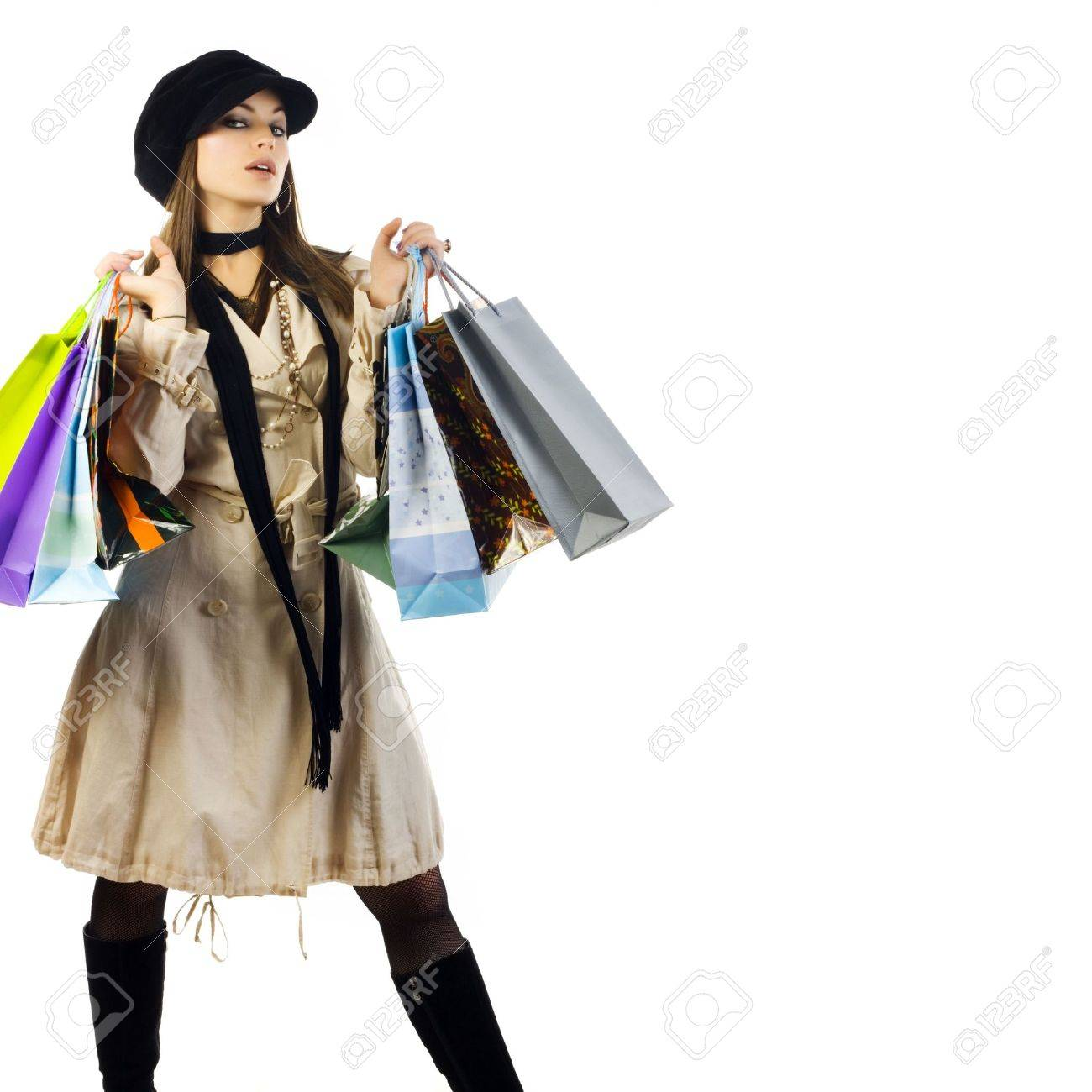 Portrait of young beautiful women with her shopping bags. Isolated on white background Stock Photo - 4356135