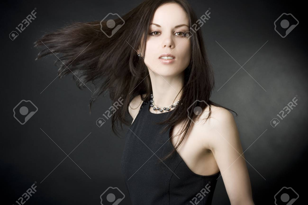 Portrait of a beautiful young woman with flying hair Stock Photo - 6314056