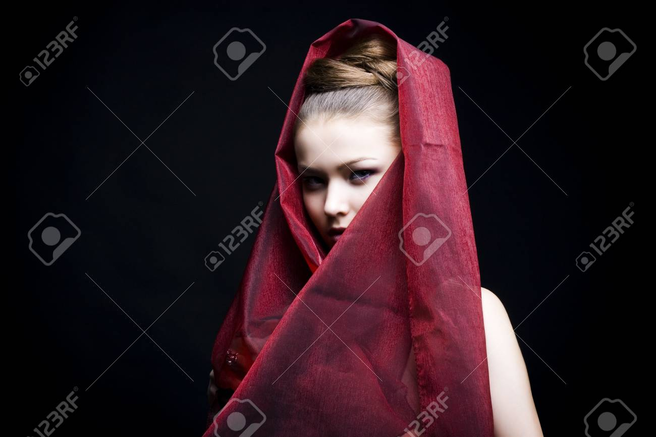 beautiful girl enveloped  in red headscarf. Fashion photo Stock Photo - 6639618