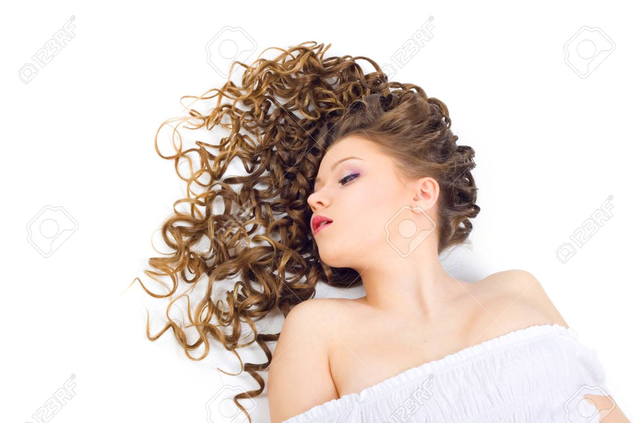 Portrait of the beautiful woman with long curly hair Stock Photo - 6689422