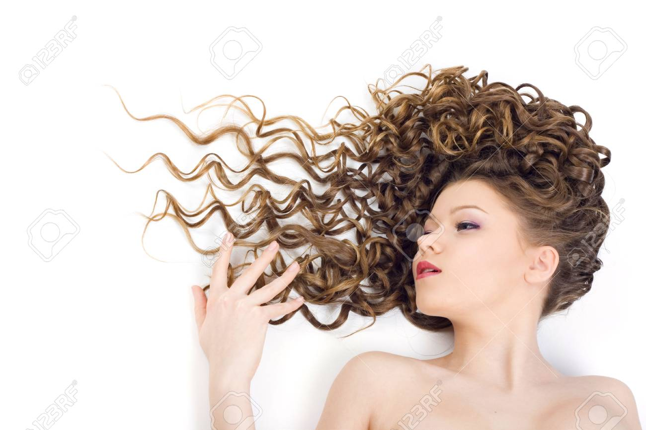 Portrait of the beautiful woman with long curly hair Stock Photo - 6689425