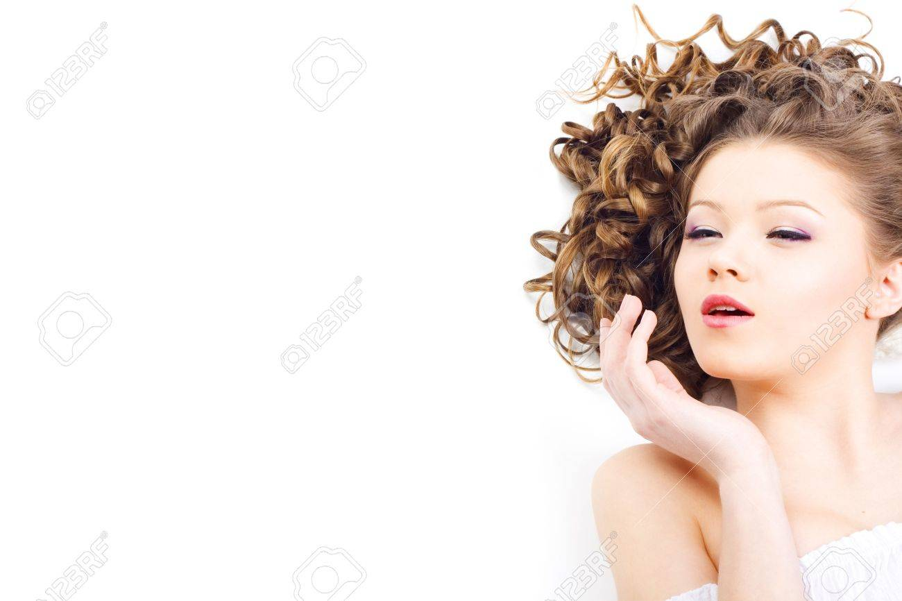 Portrait of the beautiful woman with long curly hair Stock Photo - 6689417