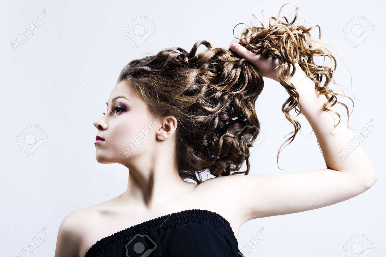 Portrait of the beautiful woman with long curly hair Stock Photo - 6715589