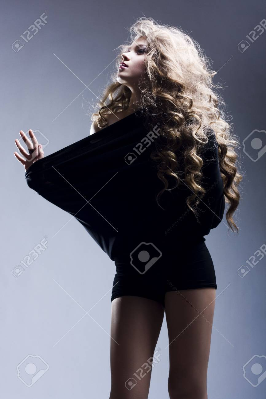 Portrait of the beautiful woman with long curly hair Stock Photo - 6736414