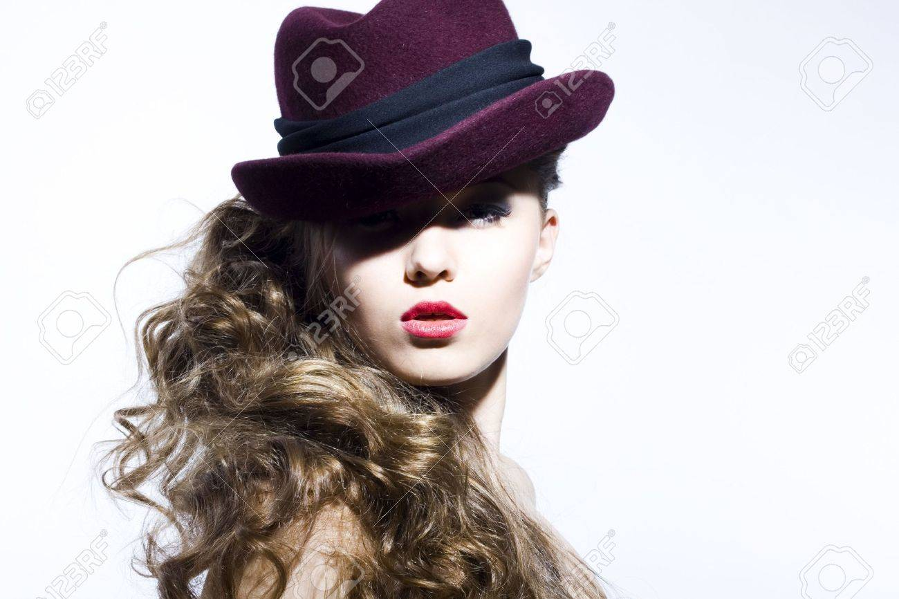 Beautiful young model in hat on the white background. Contrast photo Stock Photo - 6834719