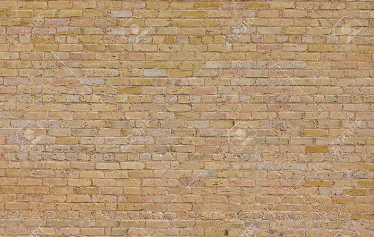 Tan brick texture pattern taken during the day - 167502792