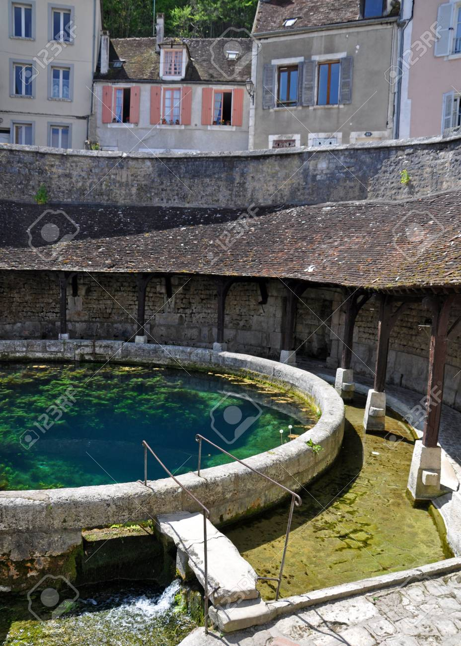 Tonnerre in the Morvan, Burgundy, France sits on the River Armancon. Famed for theTonnerre Fosse Dionne wash house - 38579739
