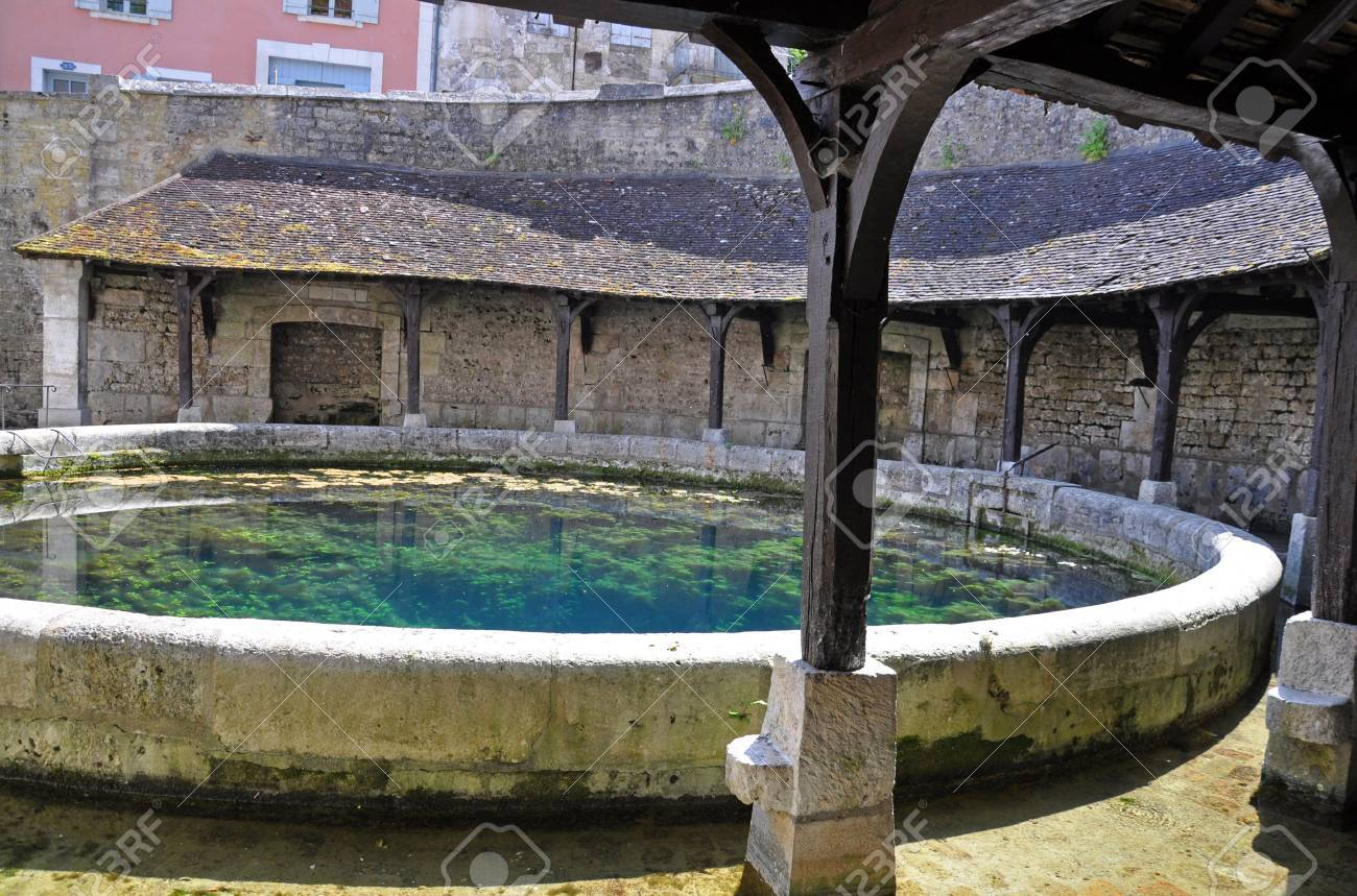 Tonnerre in the Morvan, Burgundy, France sits on the River Armancon. Famed for theTonnerre Fosse Dionne wash house - 38579754
