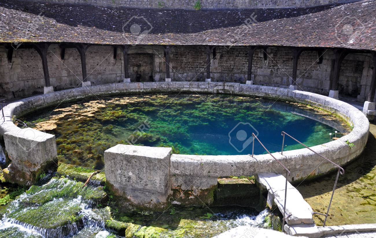 Tonnerre in the Morvan, Burgundy, France sits on the River Armancon. Famed for theTonnerre Fosse Dionne wash house - 38577034