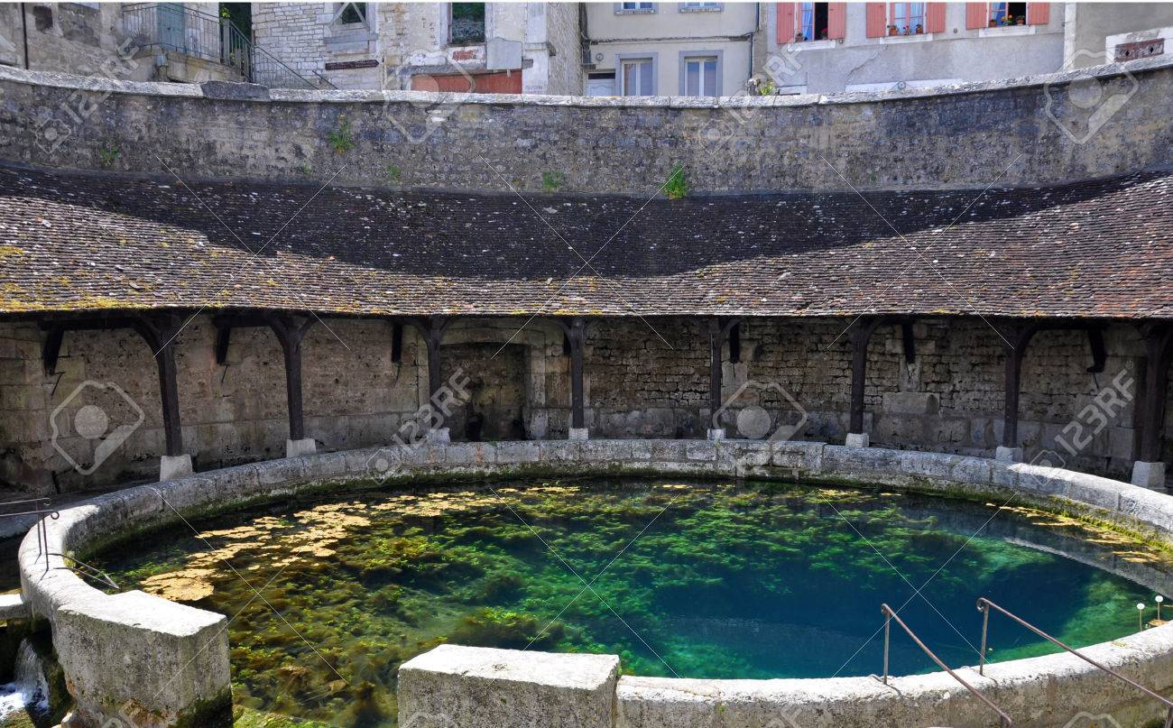 Tonnerre in the Morvan, Burgundy, France sits on the River Armancon. Famed for theTonnerre Fosse Dionne wash house - 38577035