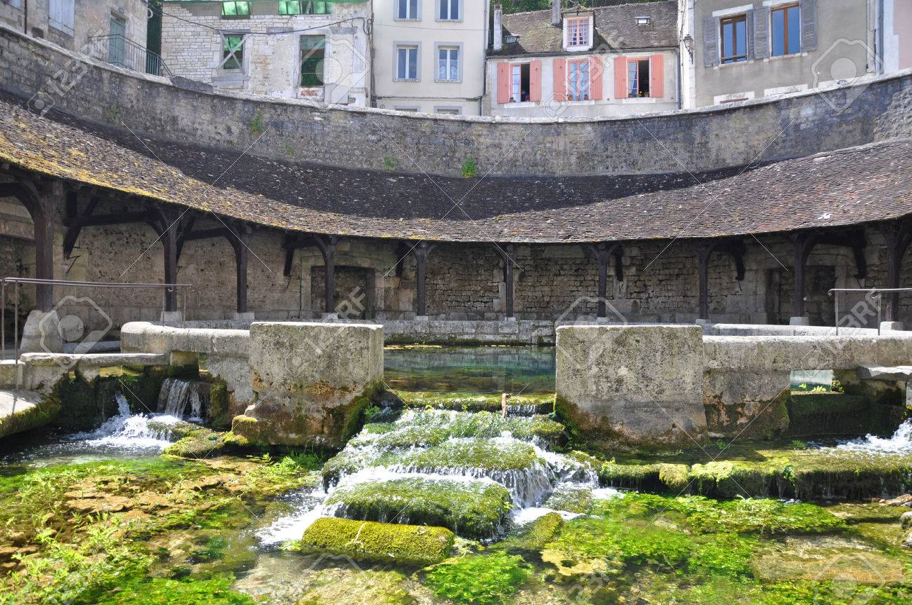 Tonnerre in the Morvan, Burgundy, France sits on the River Armancon. Famed for theTonnerre Fosse Dionne wash house - 38577036