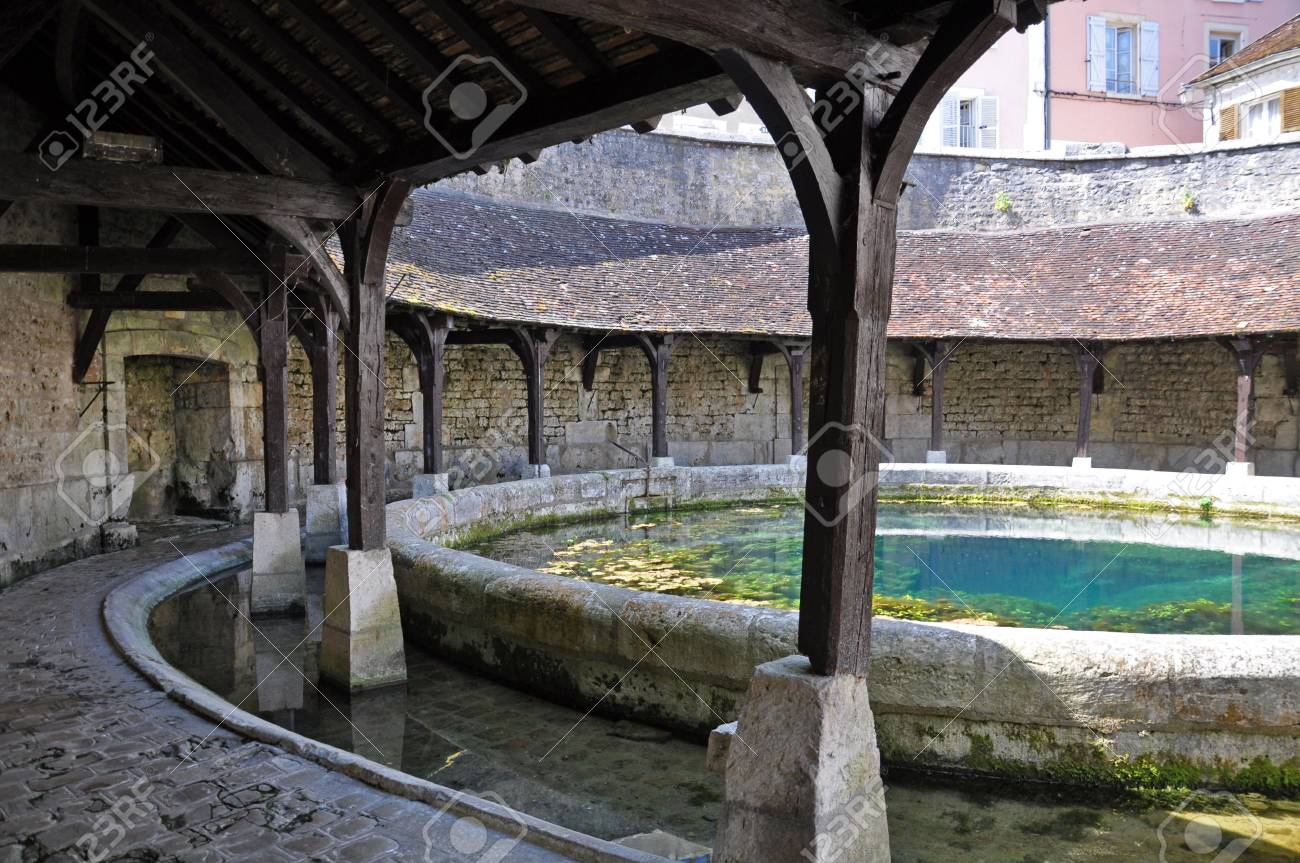 Tonnerre in the Morvan, Burgundy, France sits on the River Armancon. Famed for theTonnerre Fosse Dionne wash house - 38577088