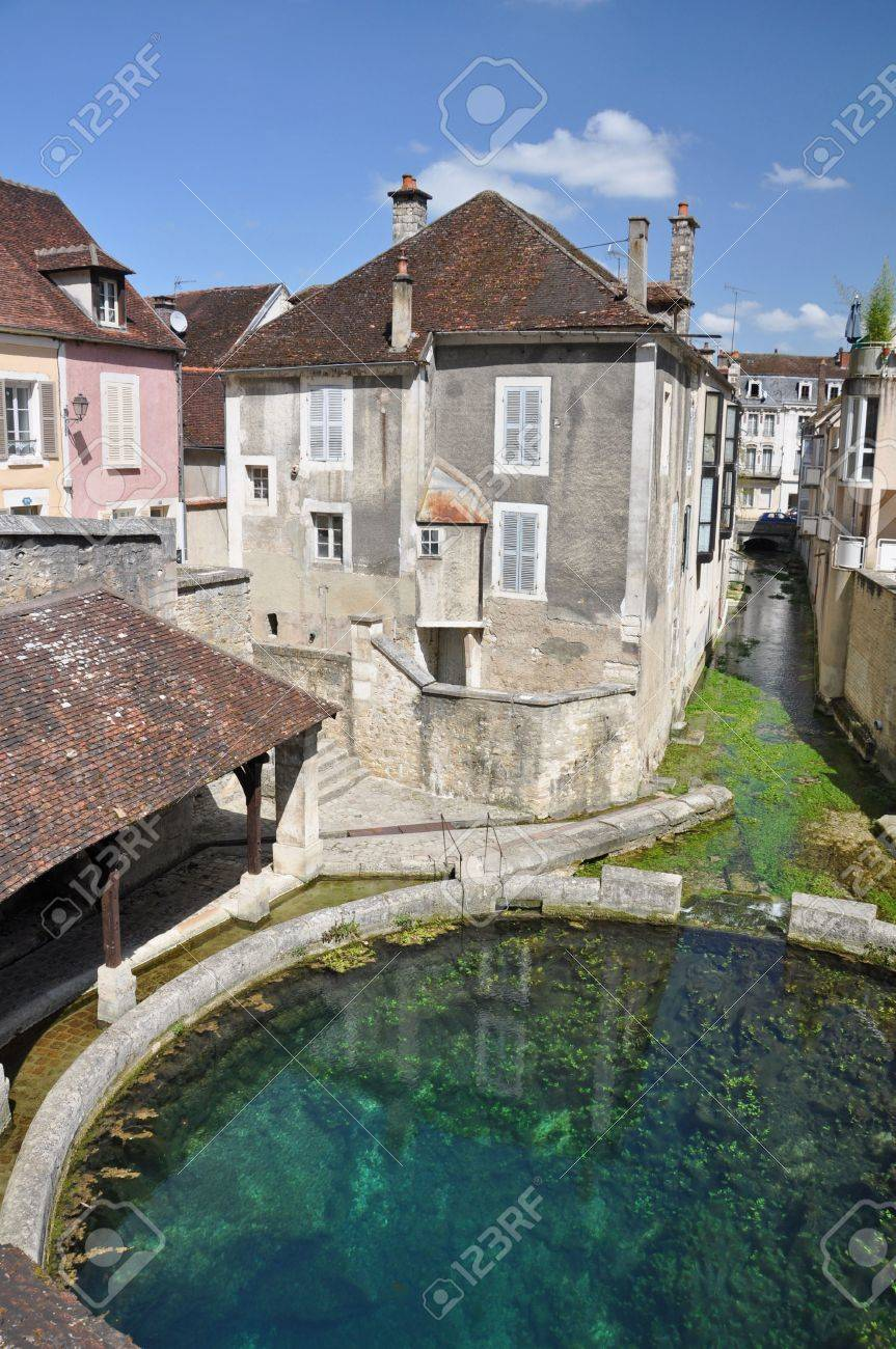 Tonnerre in the Morvan, Burgundy, France sits on the River Armancon. Famed for theTonnerre Fosse Dionne wash house - 38577089