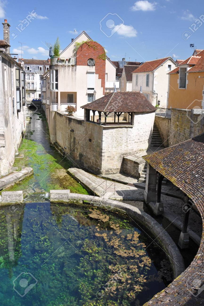 Tonnerre in the Morvan, Burgundy, France sits on the River Armancon. Famed for theTonnerre Fosse Dionne wash house - 38577091