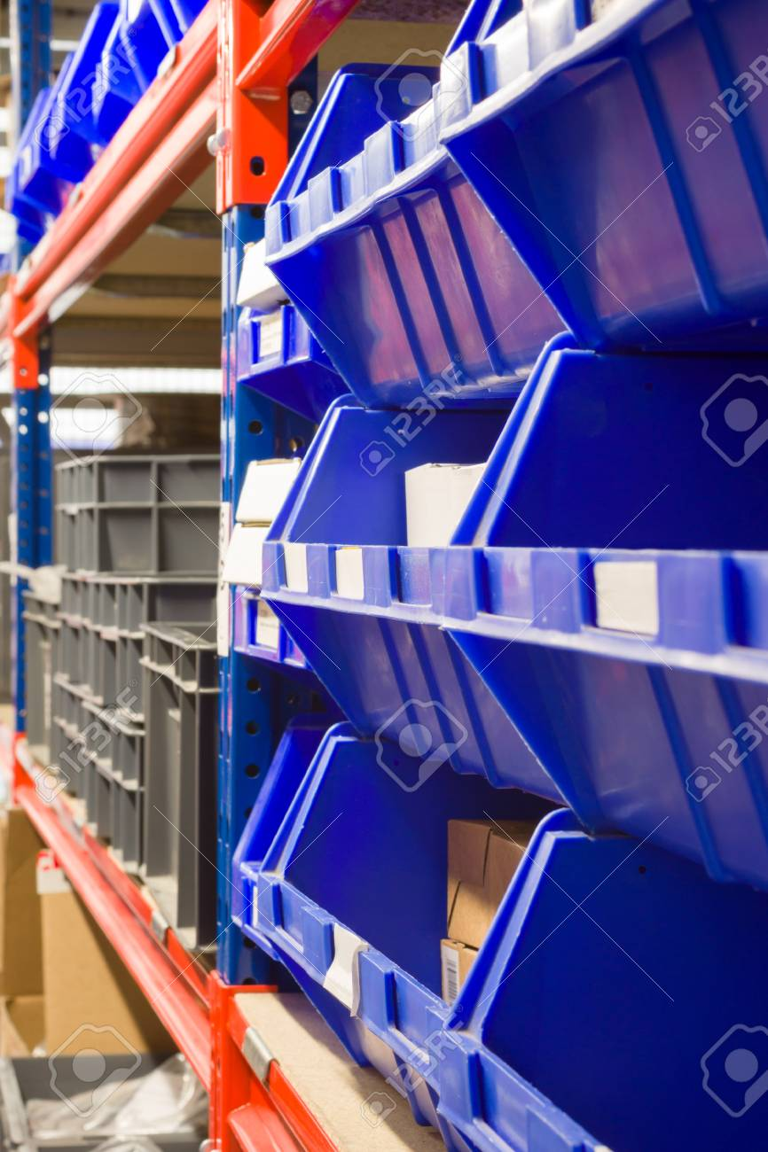Stock Photo - Storage bins and industrial storage racks in a warehouse shot with shallow focus & Storage Bins And Industrial Storage Racks In A Warehouse Shot ...