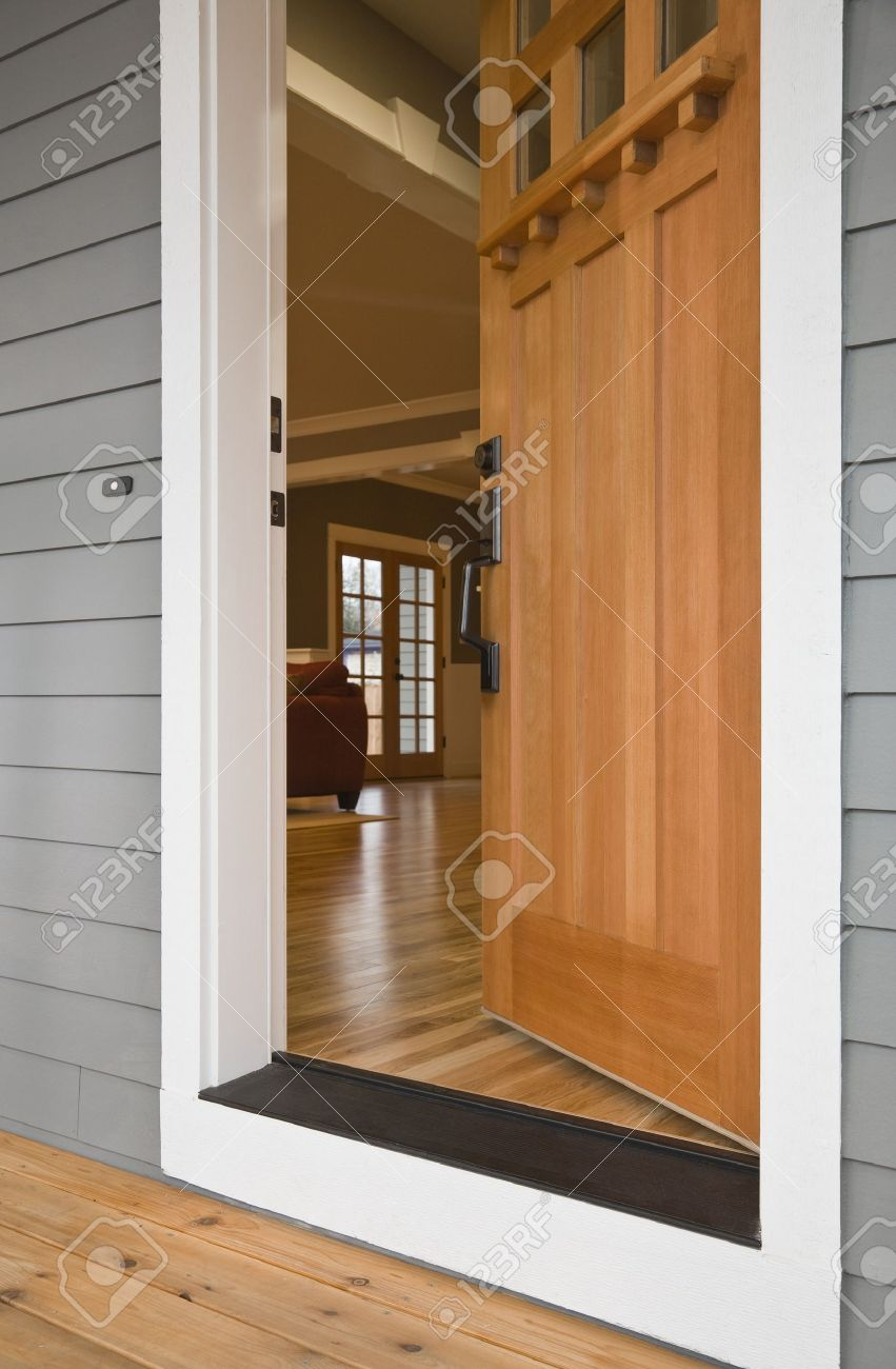 open front door. exterior view of the open front door to a residence with interior viewable from n