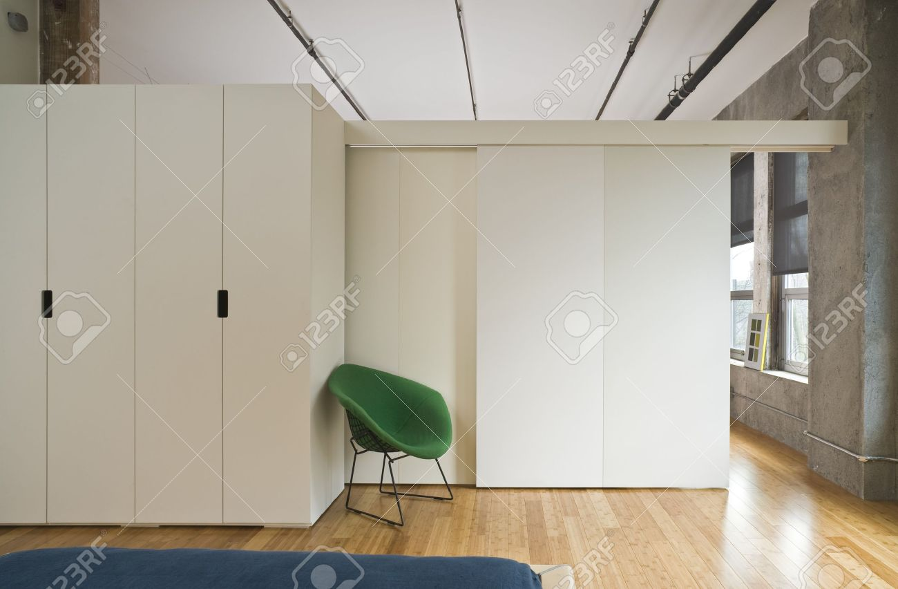 Modern style bedroom interior with room divider separating it from the rest of the loft. Horizontal shot. Stock Photo - 7094580