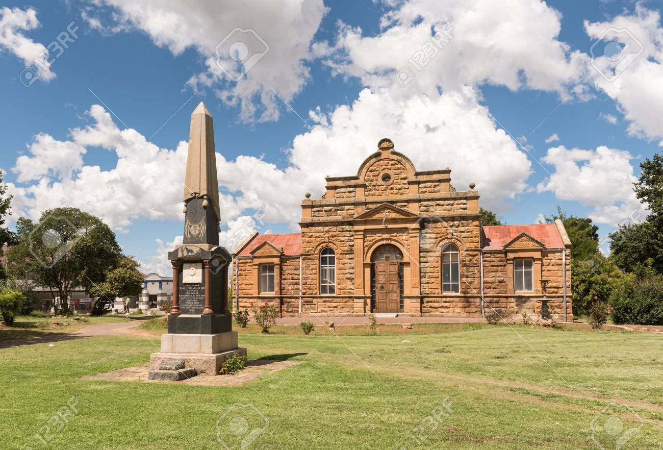 FICKSBURG, SOUTH AFRICA - MARCH 12, 2018: The sandstone town hall, completed in 1887, and the monument for General J.I.J. Fick, after whom in Ficksburg was named - 104319987