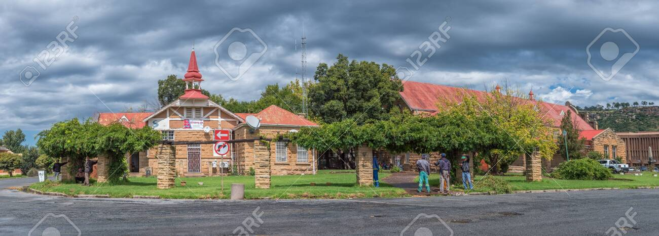 FICKSBURG, SOUTH AFRICA - MARCH 20, 2020: A panoramic street scene, with the General Jan Fick museum, the town hall and people, in Ficksburg - 147687498