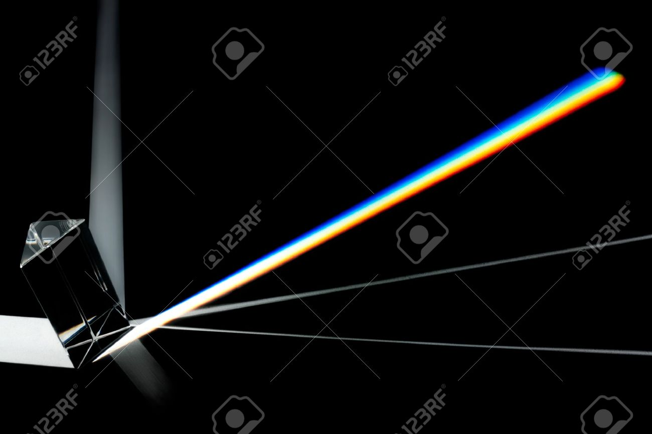 Prism splitting white light into a spectrum on a black background Stock Photo - 11799623
