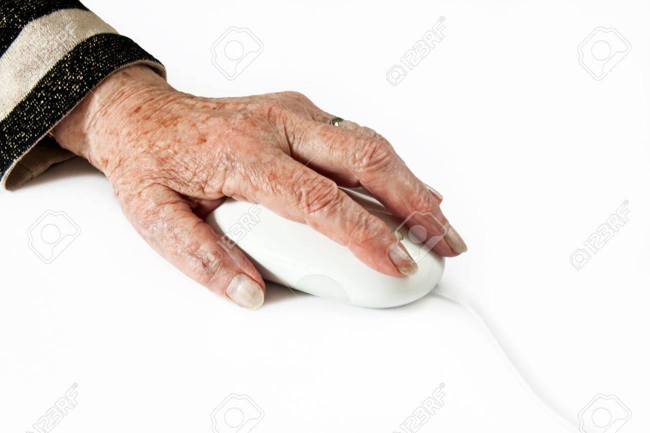 Elderly Hand on Computer Mouse on light plain background Stock Photo - 14037695