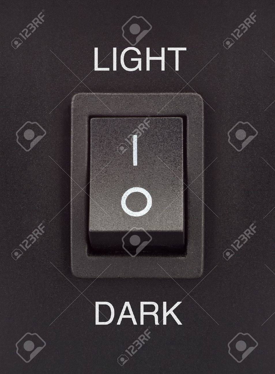 Black toggle switch on black surface - light dark Stock Photo - 14453442