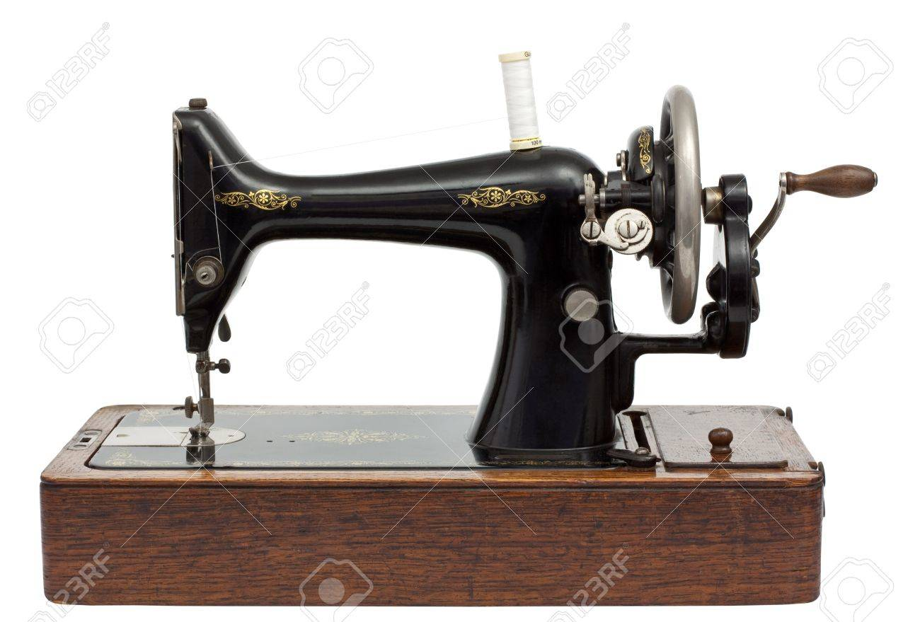 Antique Sewing Machine isolated on white with clipping path Stock Photo - 15057032