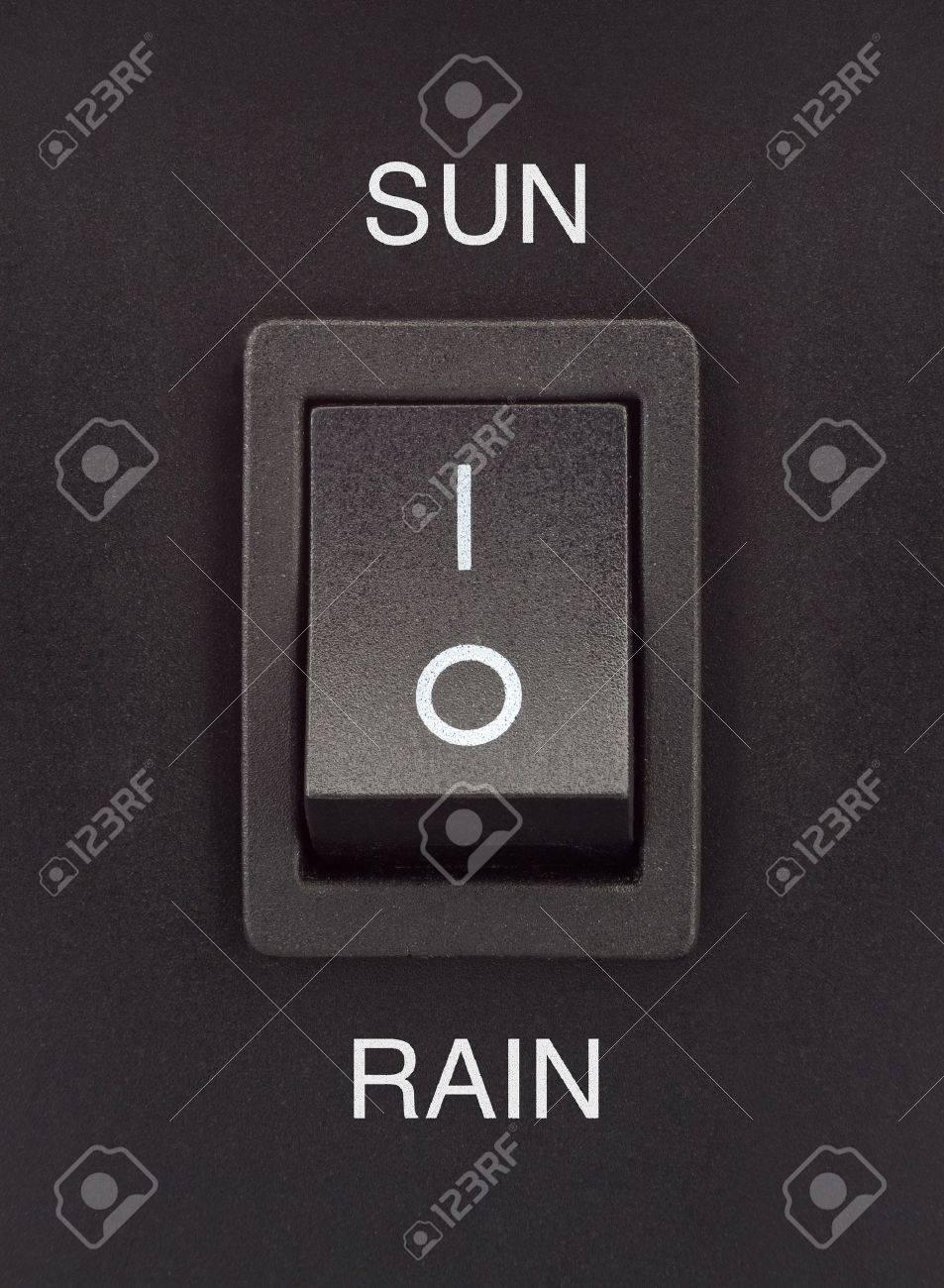 Sun or Rain black toggle switch on black surface positive negative Stock Photo - 16842328