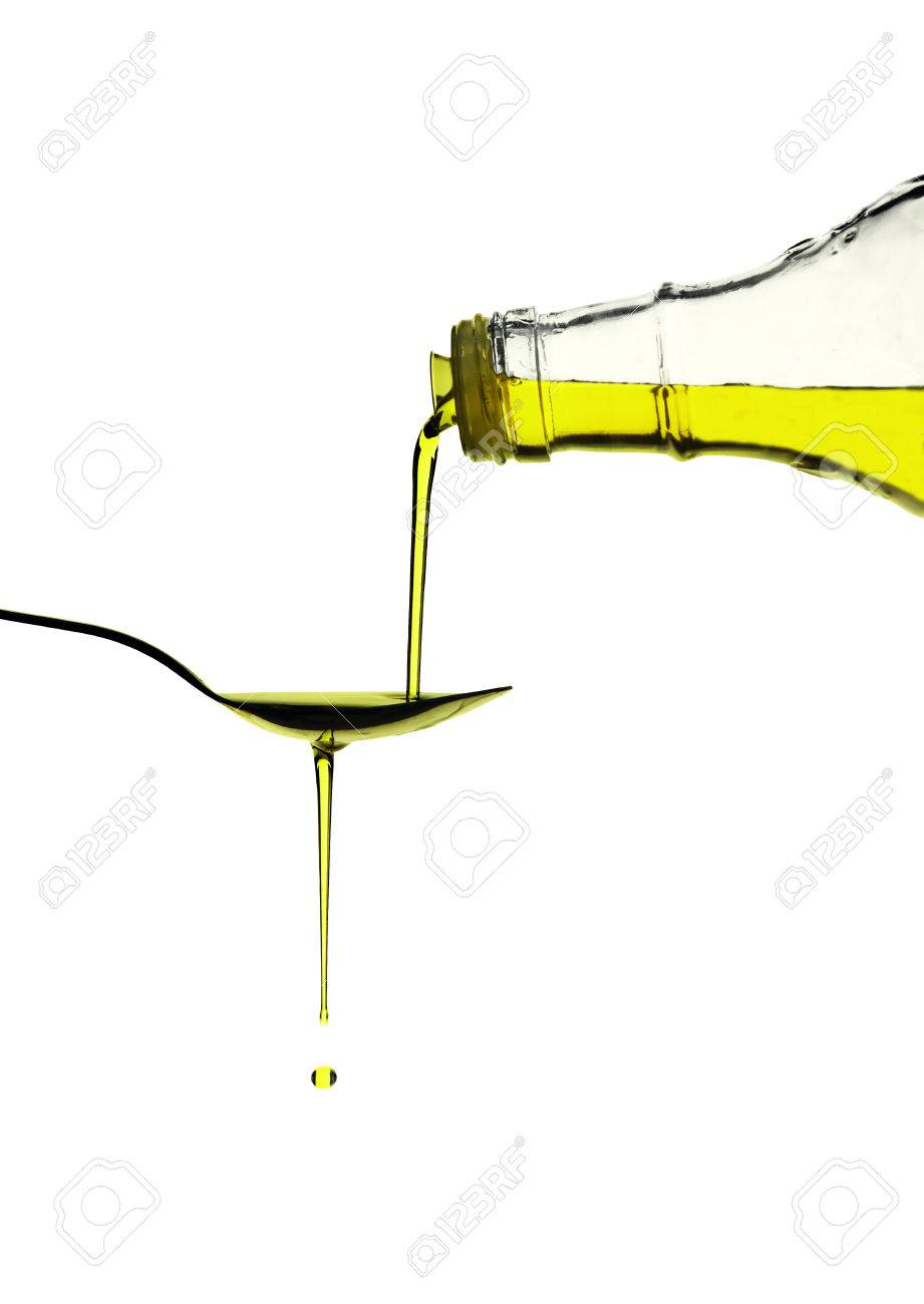 Extra virgin olive oil pouring over a spoon isolated on white with a clipping path Stock Photo - 24913771
