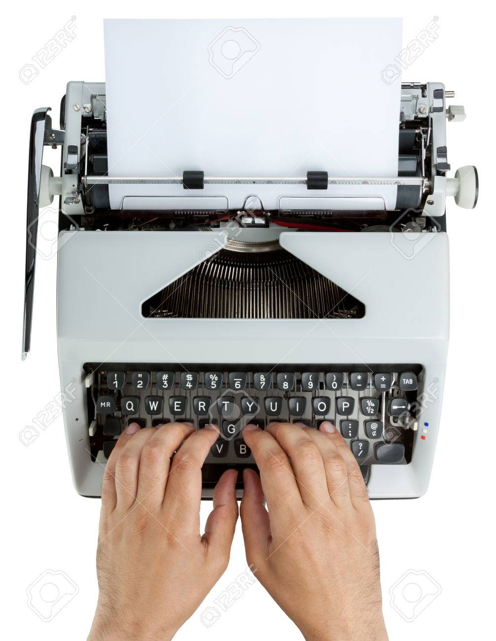 Hands on typewriter keyboard shot from above. White text on black keys. Isolated on white with clipping path Stock Photo - 28102097