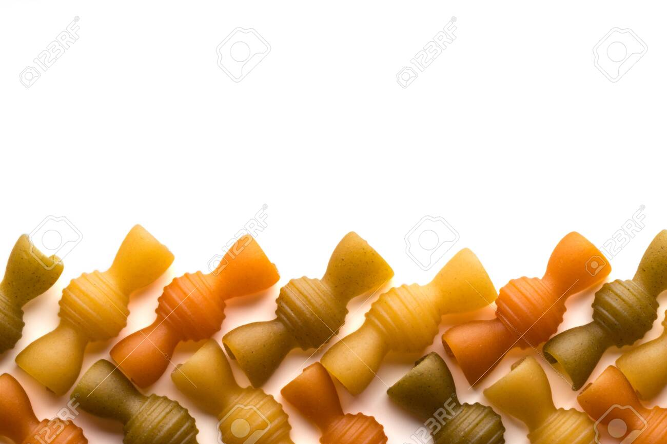 Colored italian pasta isolate on white background. Flat lay top view with space for copy. Close-up - 150426374