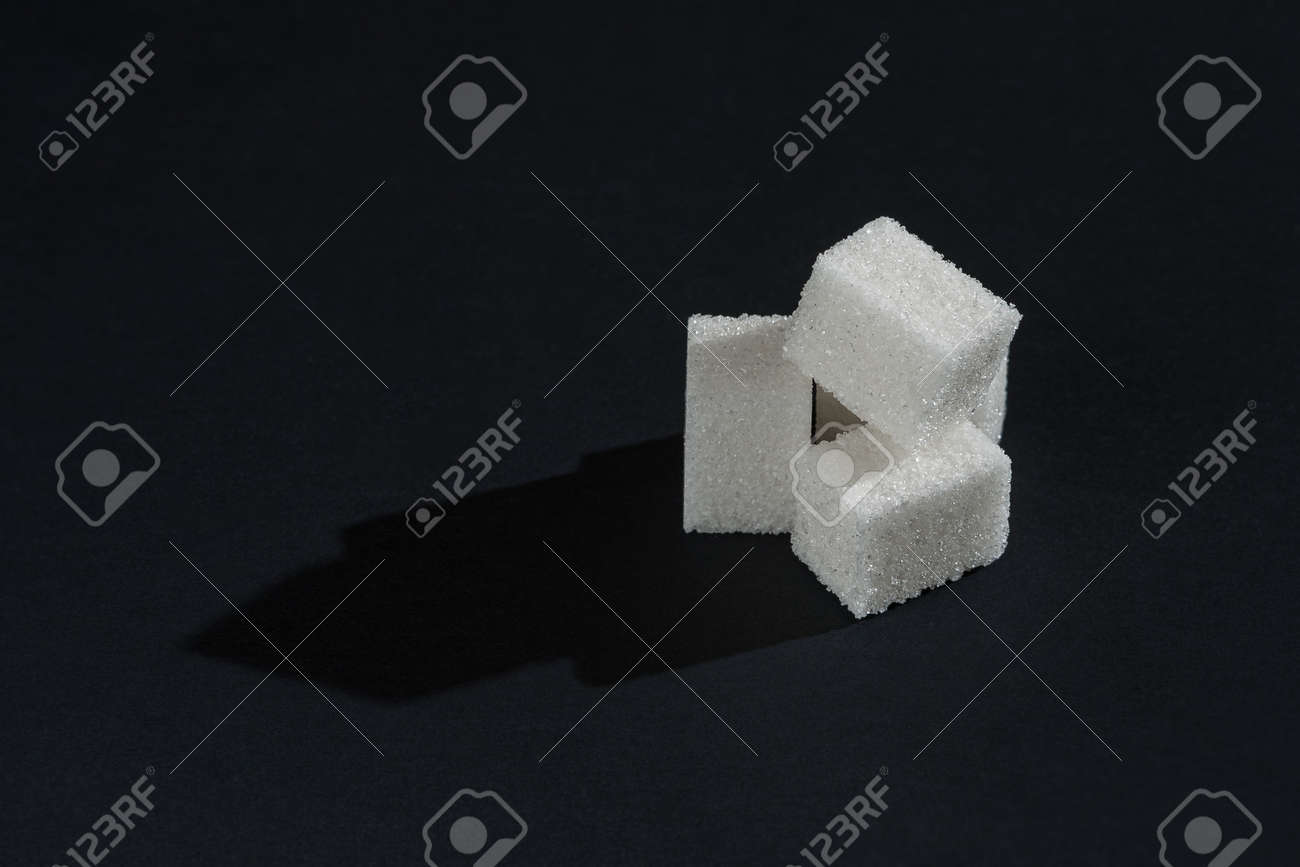White refined cubes sugar on dark background. Space for copy and text - 151632738