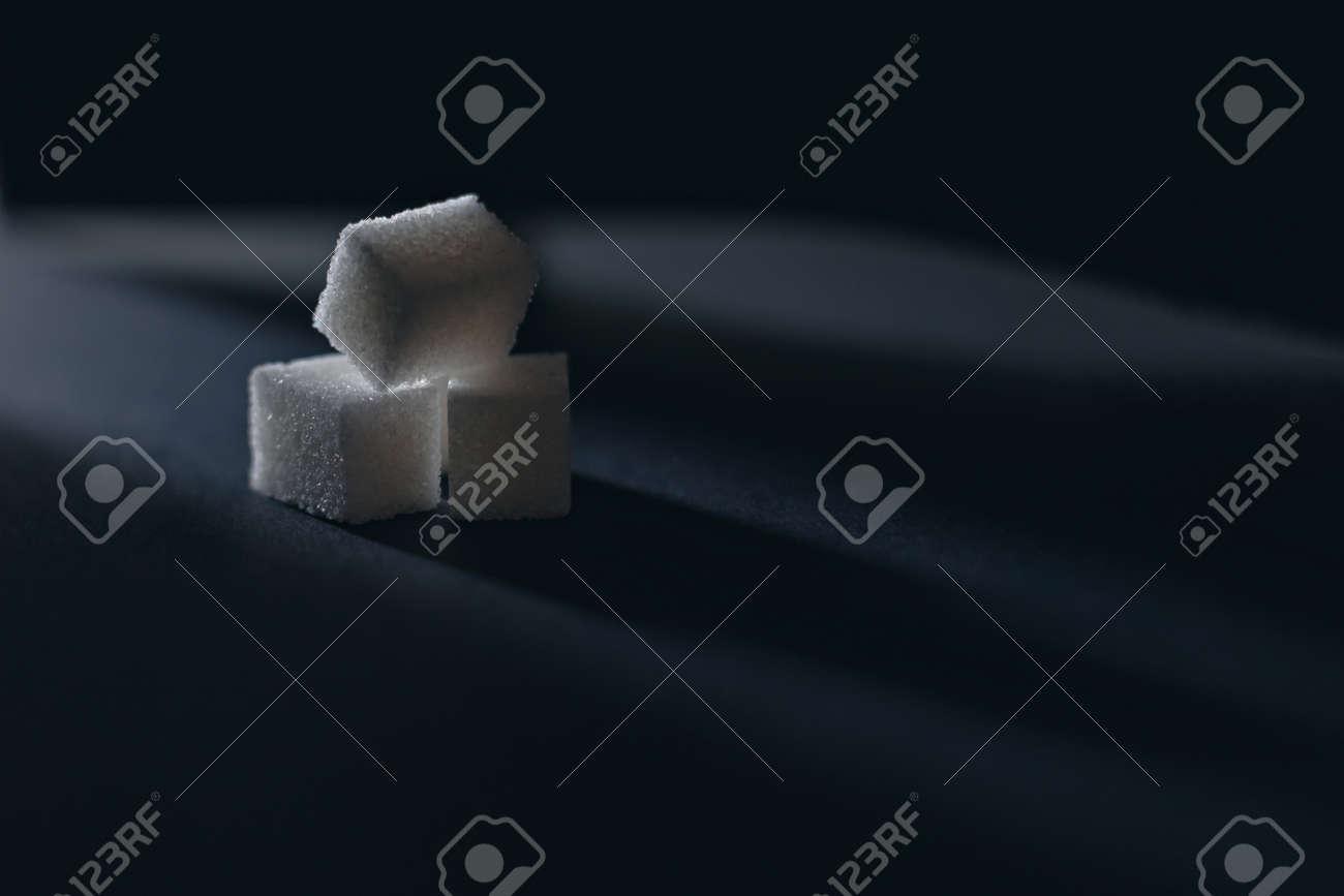 White refined cubes sugar on dark - 152137403