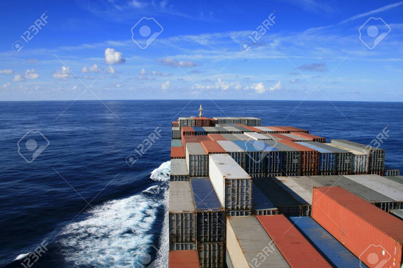 Blue sky and container ship underway - 31275725