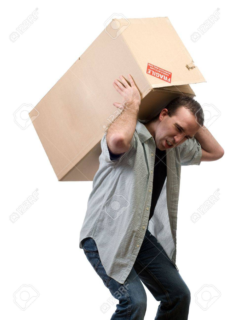 A young man lifting a larg heavy box, isolated against a white background Stock Photo - 4266987