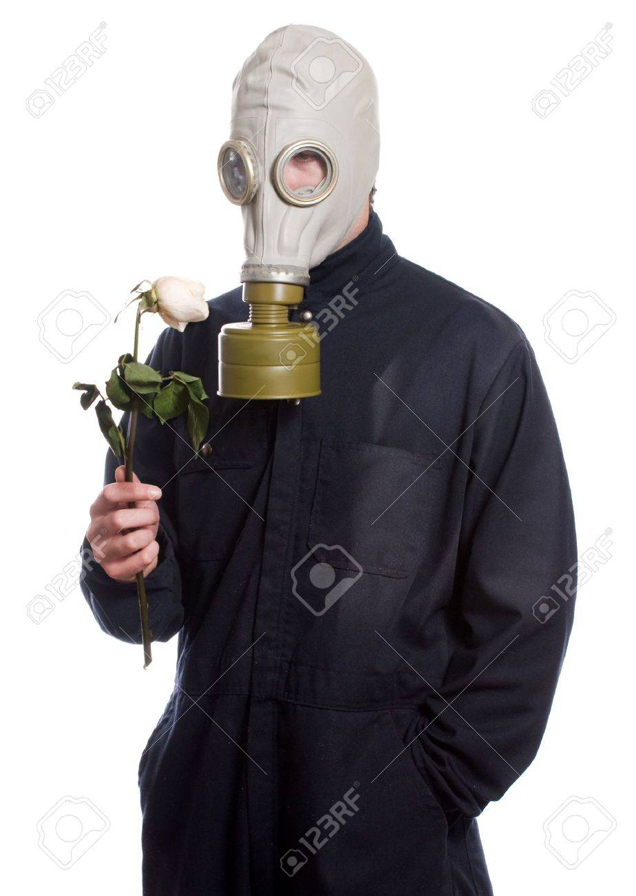 A guy wearing a gas mask is holding a wilting rose, isolated against a white background Stock Photo - 5970723