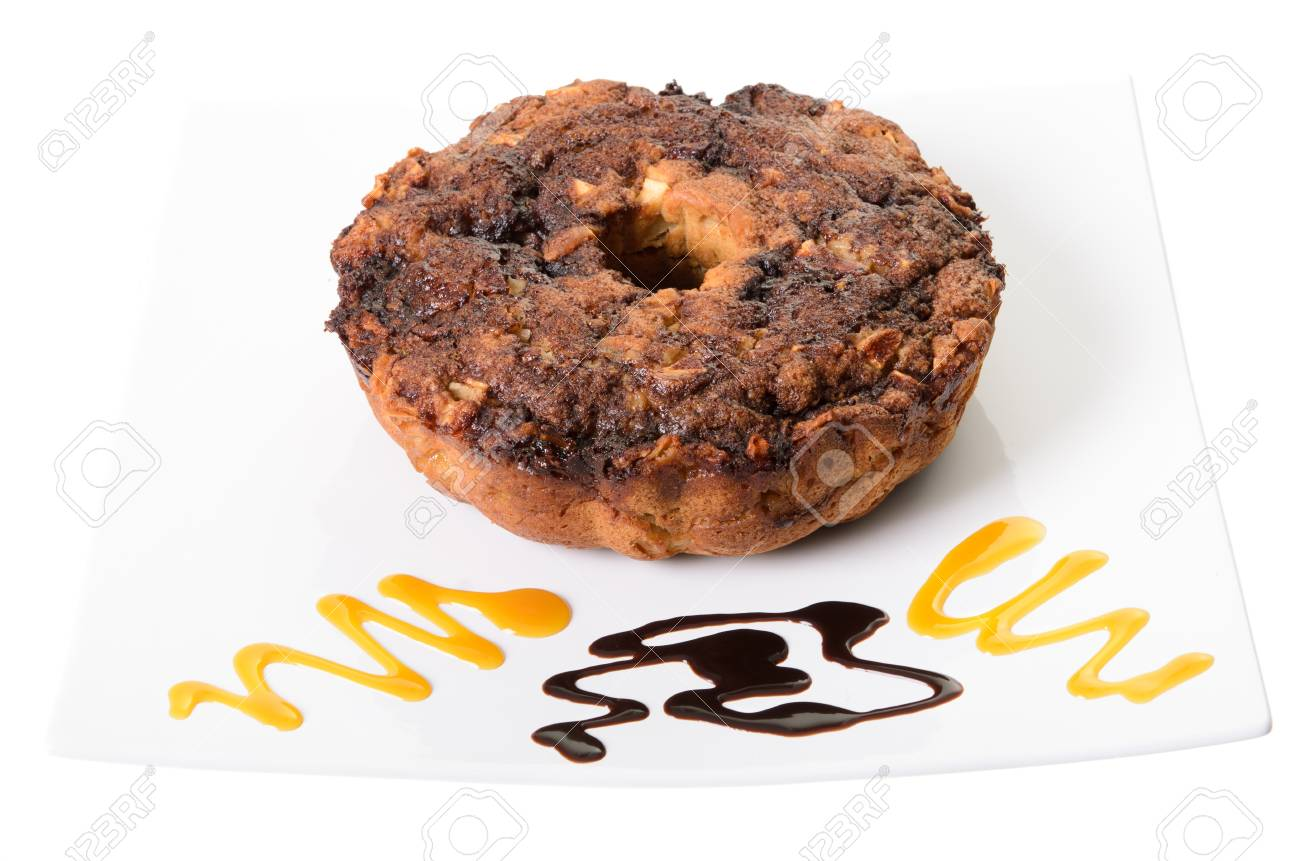 Apple coffee cake on a platter with swirls of chocolate and caramel, isolated on a white background Stock Photo - 16402752