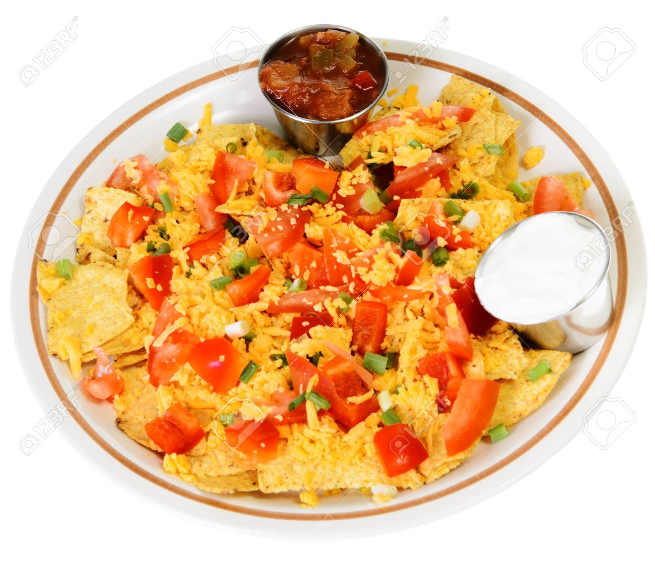 A plate of nachos and cheese, isolated on a white background Stock Photo - 16402790