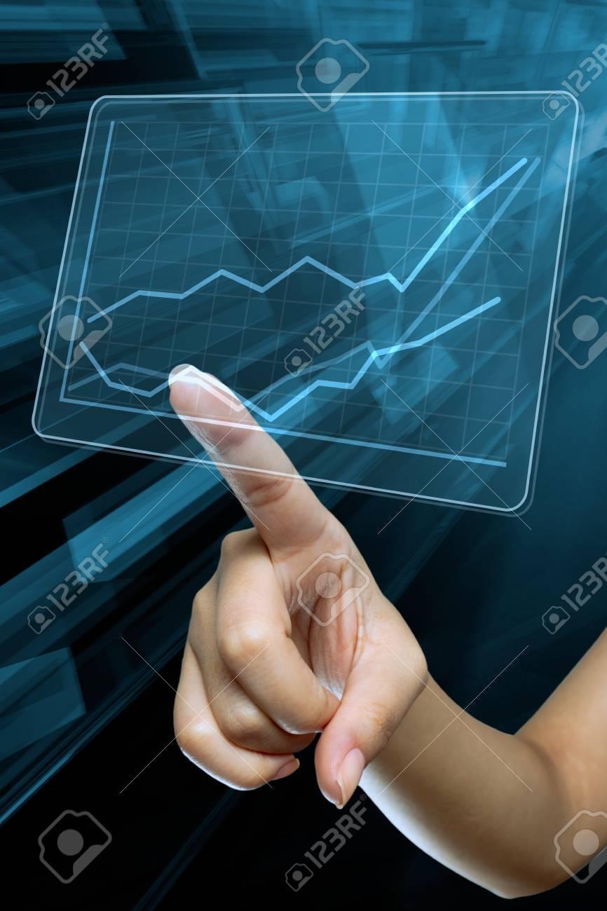 a woman hand make a graph on a digital screen Stock Photo - 19673186