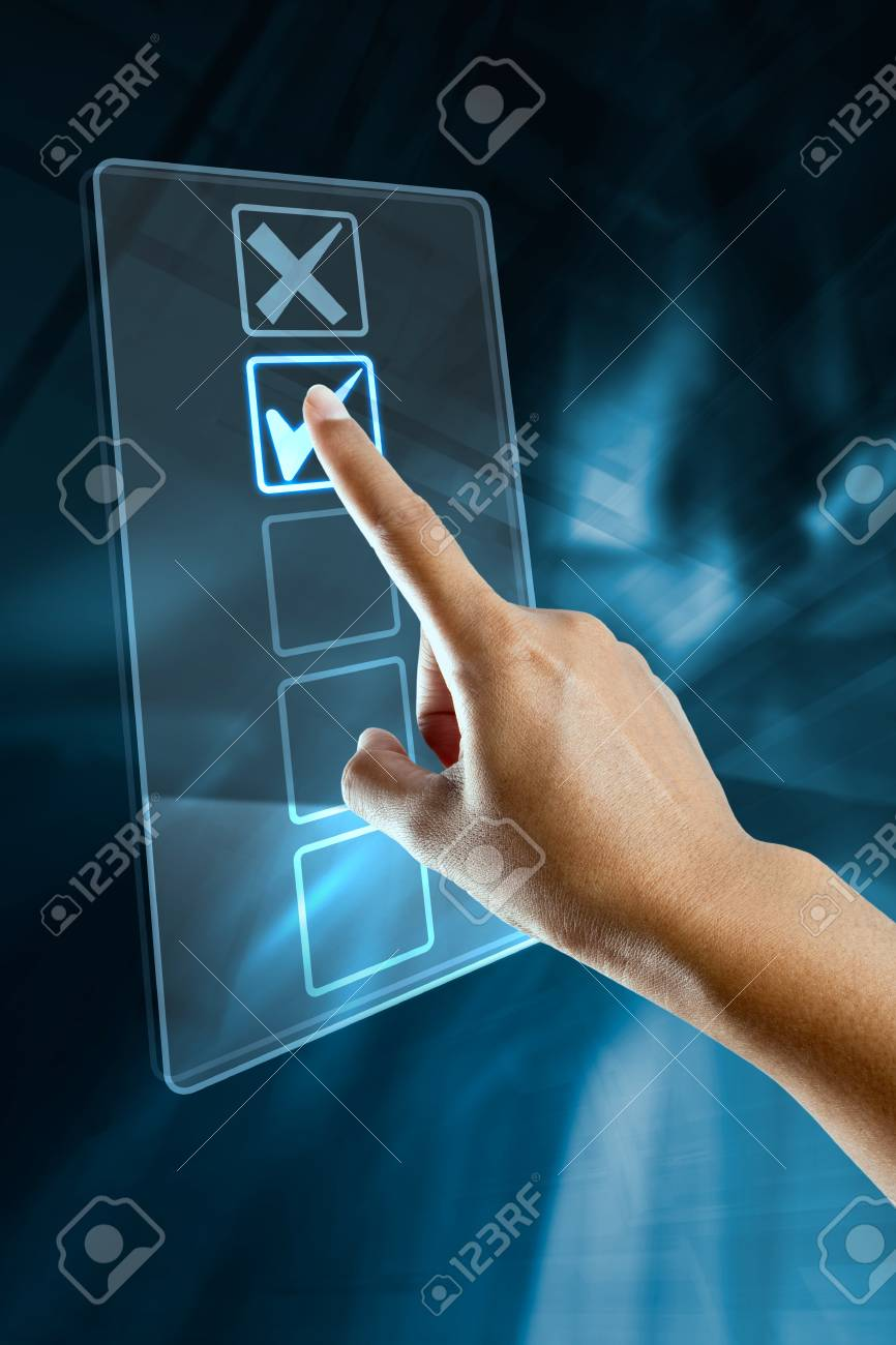 A woman hand selects an option on a screen Stock Photo - 19673184