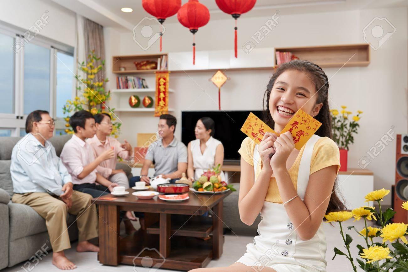 Happy little vietnamese girl holding tet greetings stock photo happy little vietnamese girl holding tet greetings stock photo 69984407 m4hsunfo