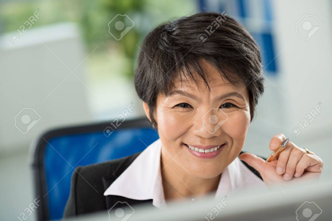 Close-up of smiling face of businesswoman - 73050891