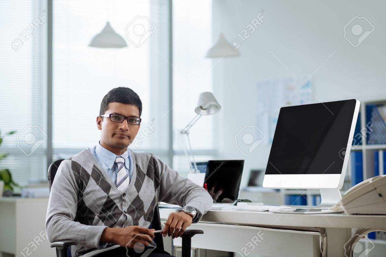 Portrait Of Confident Indian Programmer At His Workplace Stock Photo,  Picture And Royalty Free Image. Image 74810023.