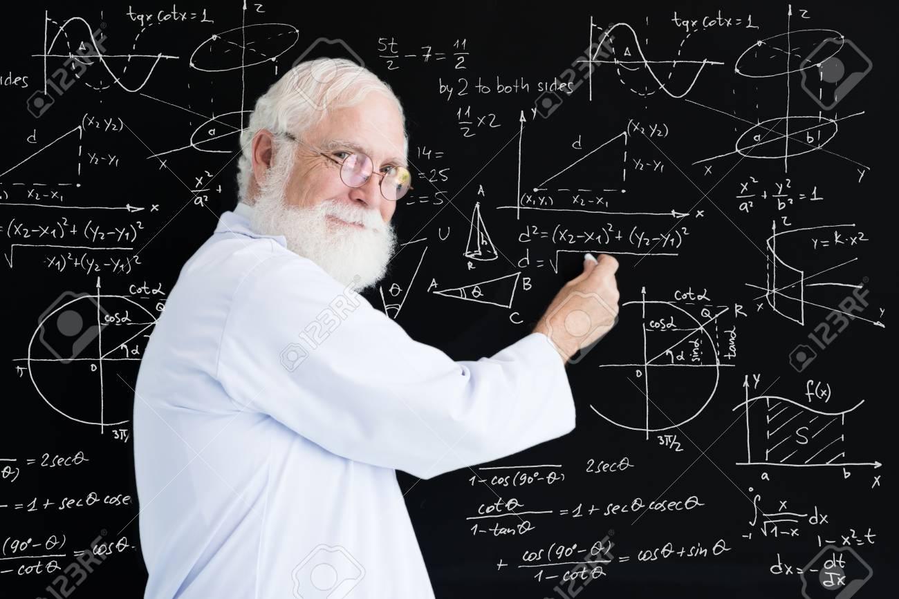 Senior Math Teacher Writing Formulas On Blackboard Stock Photo ...