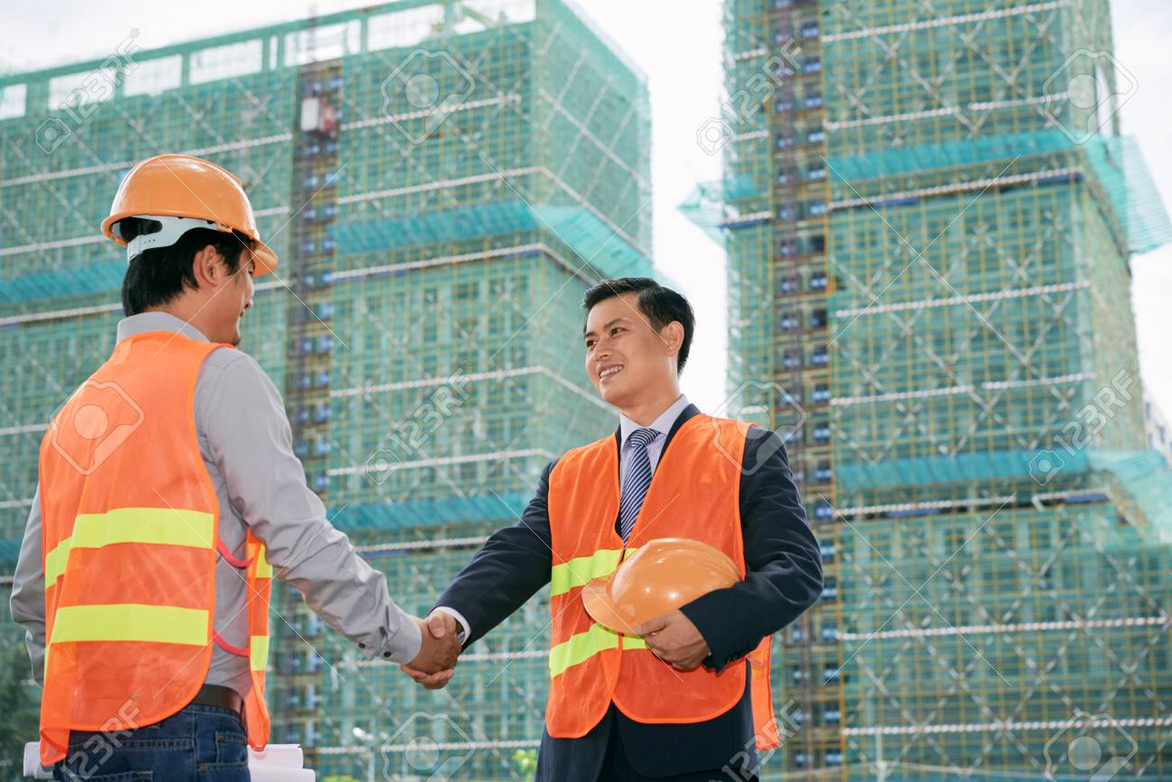 Two vietnamese construction workers greeting each other stock photo stock photo two vietnamese construction workers greeting each other m4hsunfo