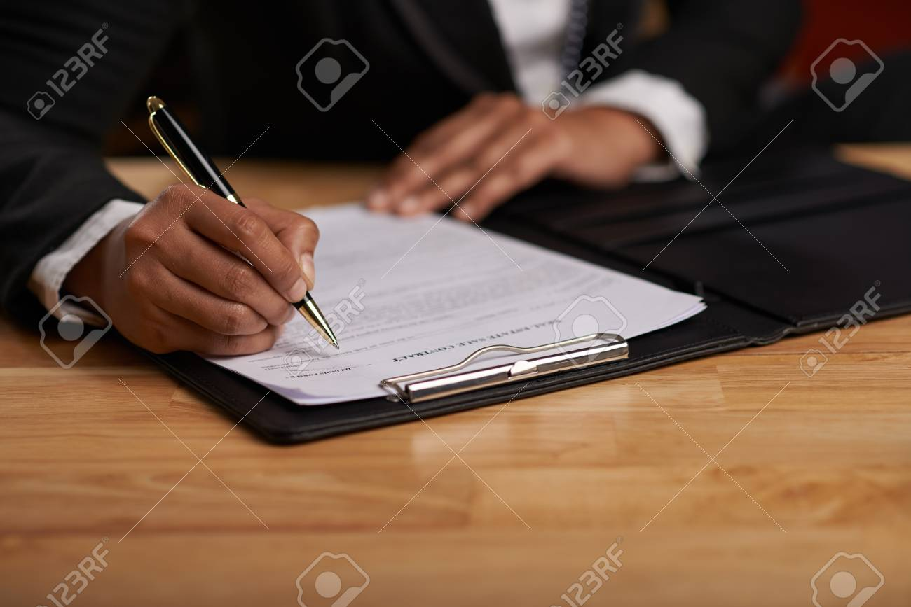 Hands of business lady signing business contract - 78151024