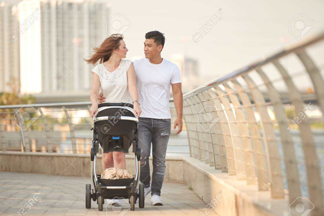 Young multi-ethnic family - 97607392