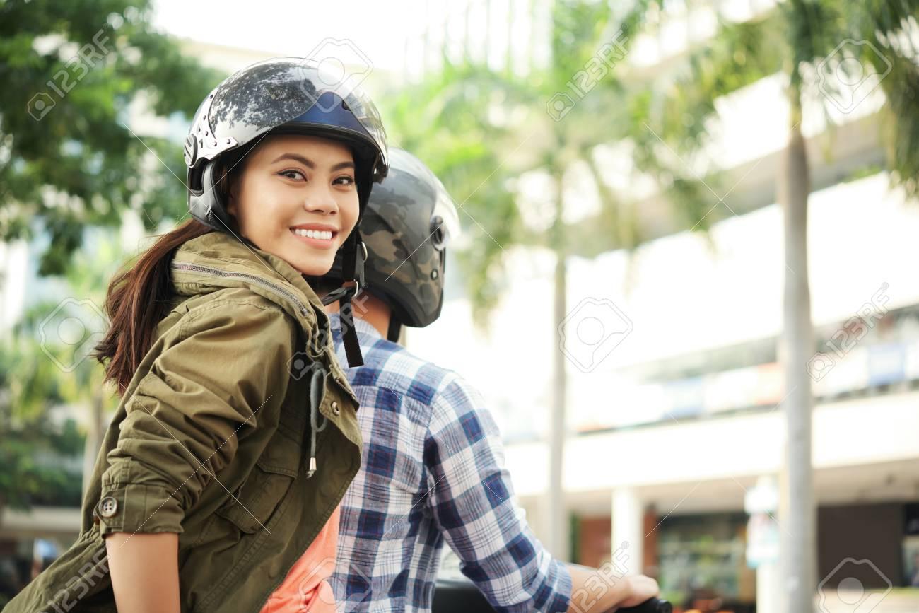 Young woman enjoyng bike ride - 104152081
