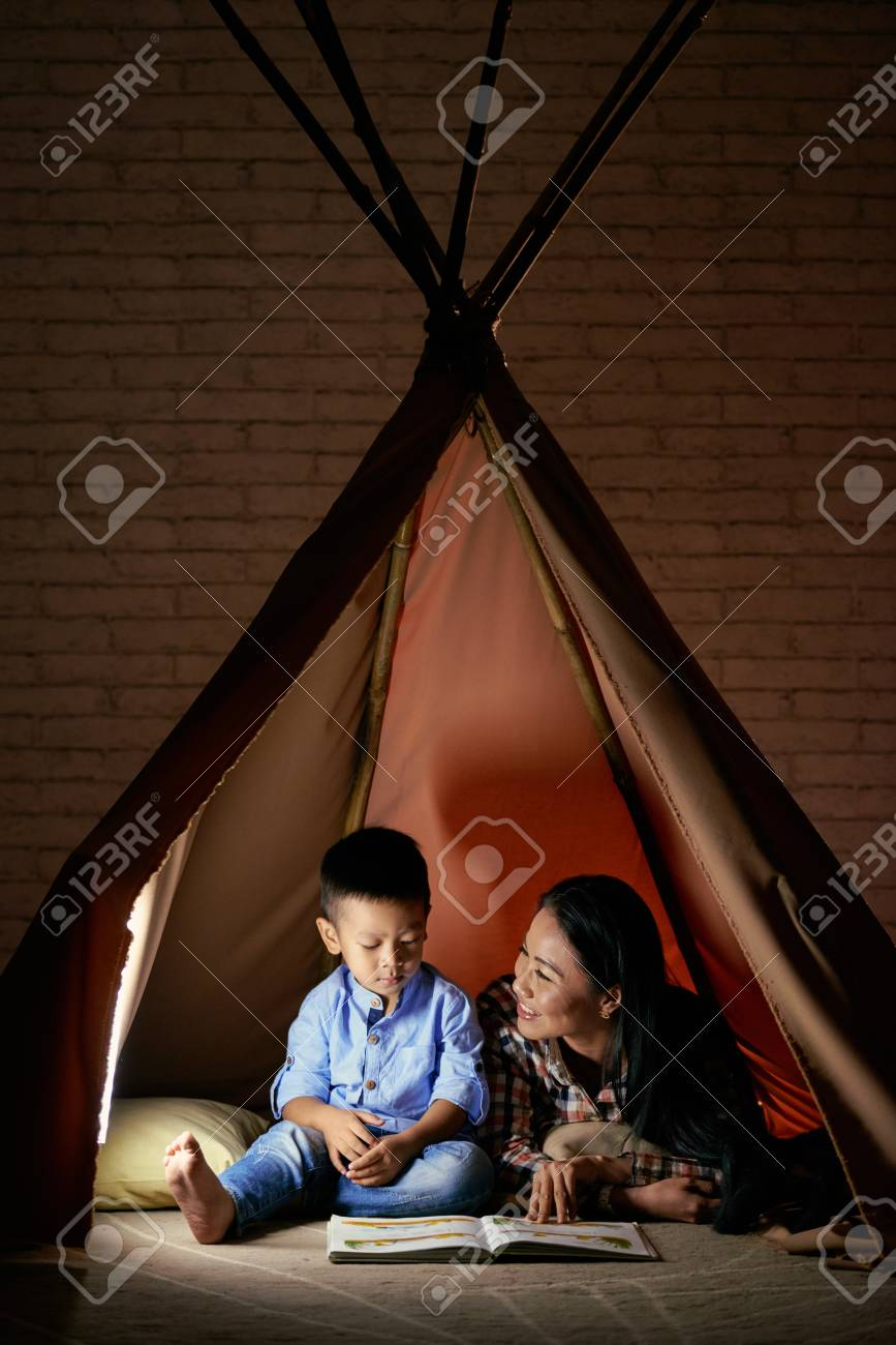 Playing in tent - 113332272
